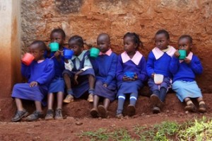 Children drinking porridge