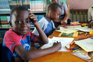 Children at a reading Baraza in a library MKMF funded.