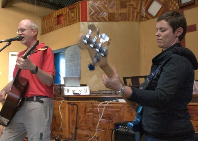 Sandi playing bass with Dale leading worship at a church in Kiburichia.